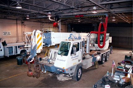 Articulating Crane Arm for Truck Repair Facility